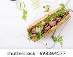 sandwich of whole wheat bread... | Shutterstock . vector #698364577