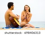 happy guy plays guitar for his... | Shutterstock . vector #698406313