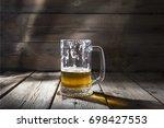 craft beer. a half drunk glass... | Shutterstock . vector #698427553