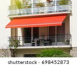 french balcony with awning... | Shutterstock . vector #698452873