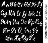 hand drawn dry brush font.... | Shutterstock .eps vector #698528053