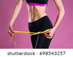perfect girl's waist with a... | Shutterstock . vector #698543257