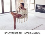 young woman chilling at home in ... | Shutterstock . vector #698626003