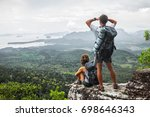 two hikers relax on top of a... | Shutterstock . vector #698646343