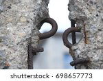 Stock photo detail of the remains of the berlin wall berlin germany segments of wall left as a reminder of 698657773