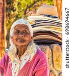 Small photo of Hat sellers would sell from a stack of hats all day long in Argentina on Mar 30, 2015