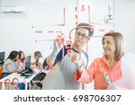 young student and teacher... | Shutterstock . vector #698706307