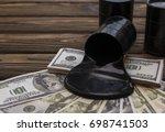 oil barrels on dollar notes.... | Shutterstock . vector #698741503