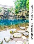 cheonjeyeon waterfalls in jeju... | Shutterstock . vector #698782633