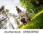 tilt image of confident friends ...   Shutterstock . vector #698828983