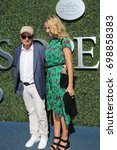 Small photo of NEW YORK - SEPTEMBER 11, 2016: American actor, producer, and activist Michael J. Fox with his wife Tracy Pollan at the red carpet before US Open 2016 men's final match at USTA National Tennis Center