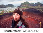 beautiful girl traveler staying ... | Shutterstock . vector #698878447