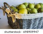 green pears in a wicker basket | Shutterstock . vector #698909947