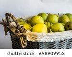 green pears in a wicker basket | Shutterstock . vector #698909953