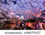 petals falling technology in... | Shutterstock . vector #698979157