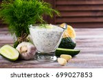 greek tzatziki sauce with... | Shutterstock . vector #699027853