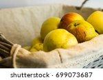 fresh harvest of apples in a... | Shutterstock . vector #699073687