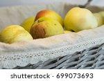 fresh harvest of apples in a... | Shutterstock . vector #699073693