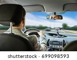 close up of a young man driving ... | Shutterstock . vector #699098593
