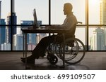 disabled businessman sitting in ... | Shutterstock . vector #699109507