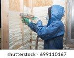 man applies foam | Shutterstock . vector #699110167