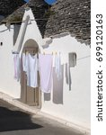 hanging white laundry in... | Shutterstock . vector #699120163