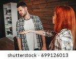 man and woman quarrel ... | Shutterstock . vector #699126013