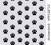 black traces of paws of an... | Shutterstock .eps vector #699128713