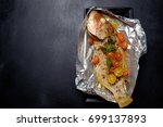 baked fish with tomatoes  herbs ... | Shutterstock . vector #699137893