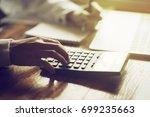 businessman's hand is using a... | Shutterstock . vector #699235663