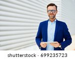 portrait of handsome middle... | Shutterstock . vector #699235723