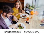 a cheerful young couple out for ... | Shutterstock . vector #699239197