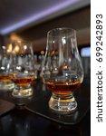 whiskey tasting  whiskey glass | Shutterstock . vector #699242893