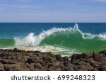 foaming white backwash from the ... | Shutterstock . vector #699248323