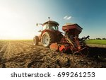 farmer with tractor seeding  ...   Shutterstock . vector #699261253
