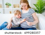 girl expecting a sister | Shutterstock . vector #699280357
