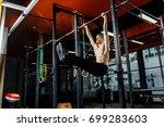 intense workout in dark gym ... | Shutterstock . vector #699283603