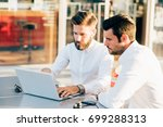two bearded business men young... | Shutterstock . vector #699288313