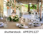 table served in rustic style | Shutterstock . vector #699291127