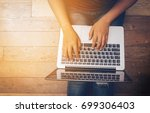 woman hands using laptop with... | Shutterstock . vector #699306403