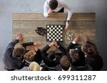 business people playing chess ... | Shutterstock . vector #699311287
