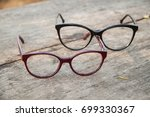 two pair of glasses on a wooden ... | Shutterstock . vector #699330367