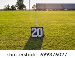 Small photo of the twenty yard line marker and the twenty yard line