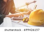 architect engineer using laptop ... | Shutterstock . vector #699426157