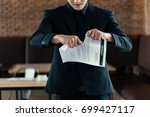 businessman tearing contract | Shutterstock . vector #699427117