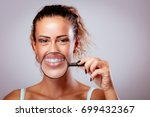 smiling girl with braces on... | Shutterstock . vector #699432367