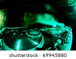 Blurred Dj At Spin Table In...