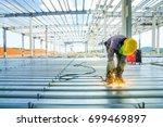 worker is welding rebar shear... | Shutterstock . vector #699469897