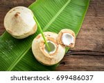 two fresh coconut fruits ready... | Shutterstock . vector #699486037