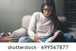 girl studying the night before... | Shutterstock . vector #699567877